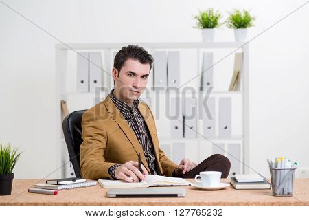 Thoughtful Man At Office Desk