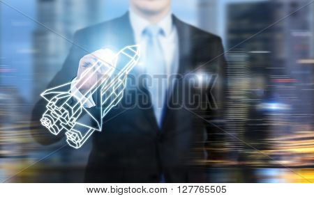 Startup concept with businessman holding abstract rocket ship on New York city background