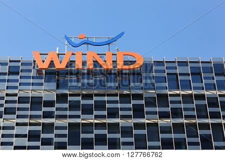 Milan, Italy - April 14, 2016: Wind logo on a building. Wind is an Italian telecom operator which offers integrated mobile, fixed and Internet services