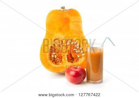 half of pumpkin pumpkin juice and apple isolated on white background