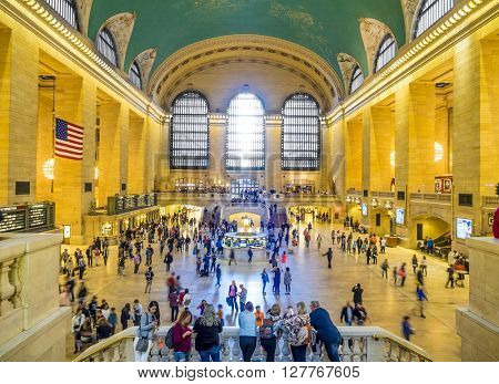 New York, NY - April 24, 2016: people commute at noon on April 24, 2016 at the famous Grand Central terminal in New York City