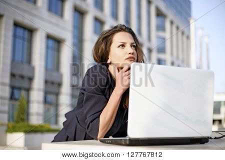 Beautyful woman student working outside with laptop