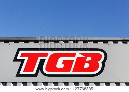 Villefranche, France - March 27, 2016: TGB logo on a wall. Taiwan Golden Bee also known as TGB is a Taiwanese manufacturer of scooters, all terrain vehicles and engines in general