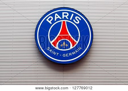Paris, France - March 28 2016: PSG logo on the wall of Parc des Princes. Paris Saint-Germain Football club, commonly referred to as PSG, is a French professional association football club based in Paris