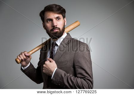 Businessman With Bat On Shoulder