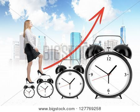Success concept with businesswoman climbing alarm clock ladder with an upward chart arrow on New York city background