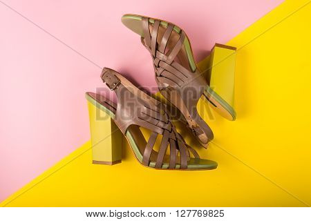 Stylish Shoes On A Pink And Yellow Background