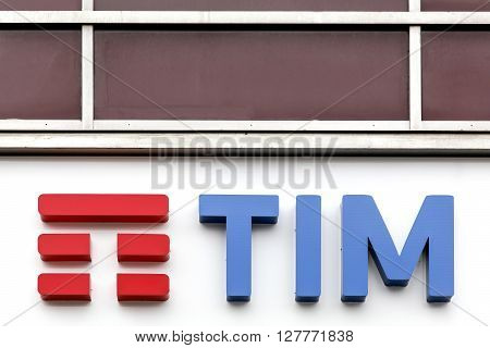 Milan, Italy - April 15, 2016: TIM logo on a wall. Telecom Italia Mobile, also known as TIM, is an Italian mobile phone network brand since 1995