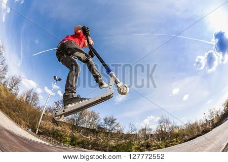 Boy Jumping With A Scooter
