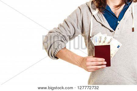 Tourist holding passport full of money. Summer vacation travel. Isolated on white background.