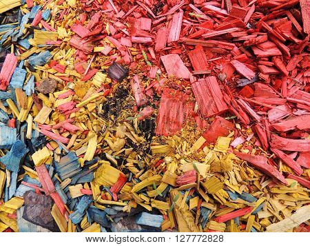 Decorative mulch of wood chips. Color background