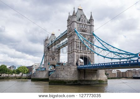 London Bridge and Thames River with cloudy sky