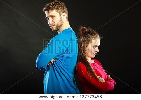 Offended upset young couple not talking to each other standing back to back after argument quarrel. Unhappy man and woman. Disagreement in relationship.
