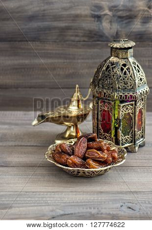 Arabian lantern golden lamp and fruits. Islamic holidays decoration. Ramadan kareem