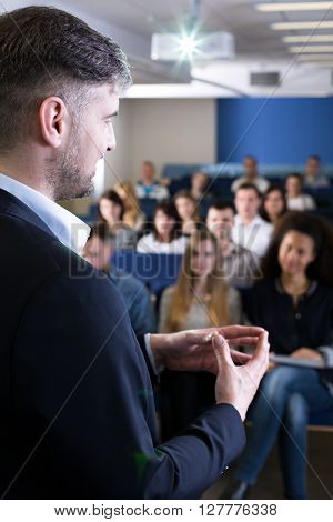 Over the shoulder look of a teacher giving a lecture
