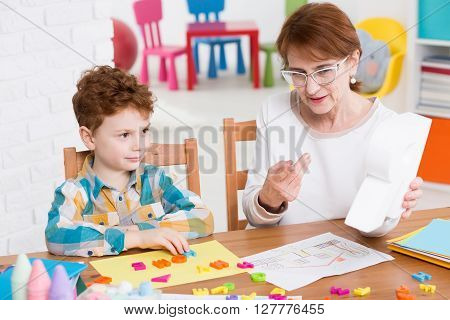 Speech Therapist And Little Patient