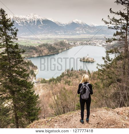 Made it. Young spoty active lady admiring beautiful nature around Bled Lake in Julian Alps, Slovenia.