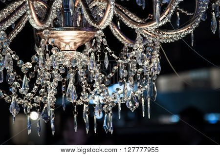 Chrystal chandelier close-up shot glittering in light