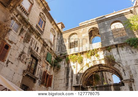 SPLIT CROATIA - SEPTEMBER 2 2009: The arch and upper section of the Iron Gate (Porta Ferrea) and adjacent building at Diocletian's Palace