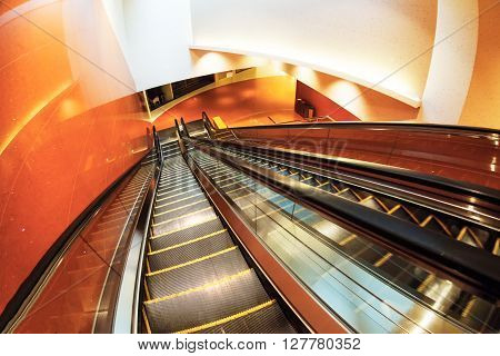Escalator In Modern Office Building Or Subway, Abstract Architecture Background. Red Toned Images.