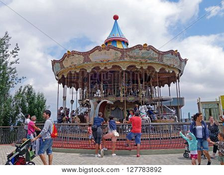 BARCELONA, SPAIN - AUGUST 1, 2015: Old carousel attraction in the Tibidabo Amusement Park, Barcelona, Spain