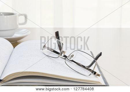 Eyeglasses Put On A Book With On The Desk