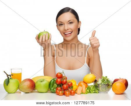 beautiful woman with healthy food showing thumbs up