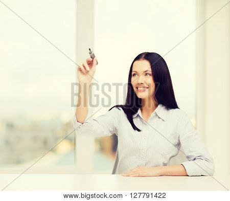 business, education and technology concept - smiling woman writing on virtual screen