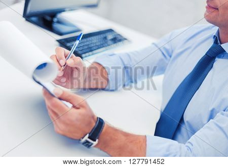 business, office, school and education concept - businessman working and signing papers