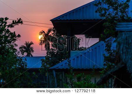 Dawn Sun raise up the roof level thailand country