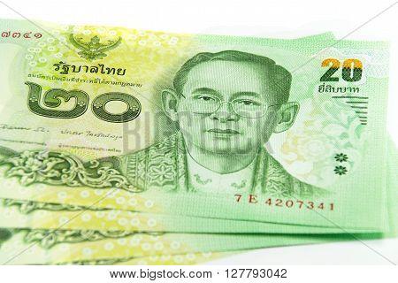 Closed up Thai banknote twenty baht isolated on white background