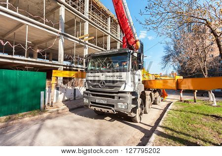 SAMARA RUSSIA - APRIL 26 2016: Automobile concrete pumping machine able to pump concrete in large quantities at the construction building