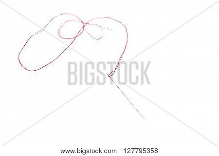 Small needle with red thread isolated over the white background