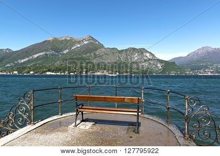 bench with beautiful views of Lake Como in a quiet and sunny spring morning Bellagio