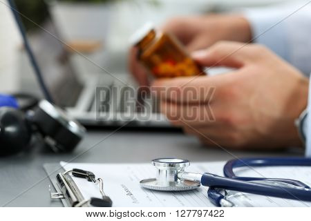 Medical Stethoscope Lying On Clipboard Pad Closeup