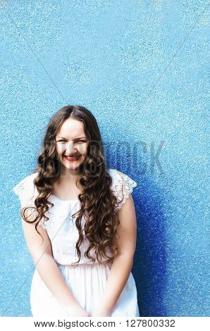 Portrait of a beautiful young girl of 20 years old in a summer dress outdoors in summer park