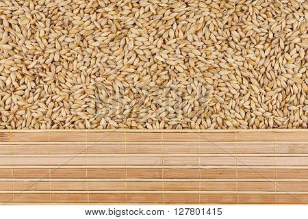 Barley grains and bamboo mat with place for your text