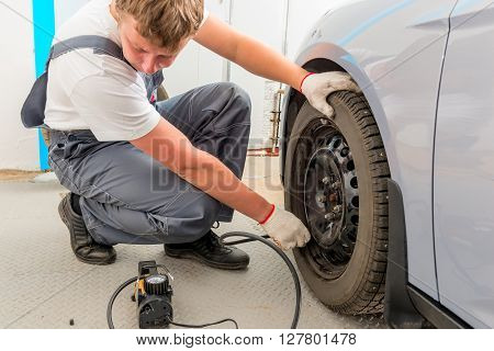 Mechanic Checks The Degree Of The Wheel Pump