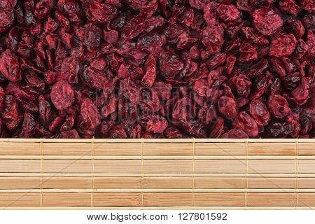 Dry cranberries and bamboo mat with place for your text