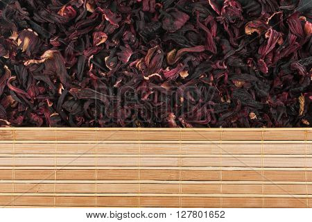 Dried flowers of hibiscus and bamboo mat with place for your text
