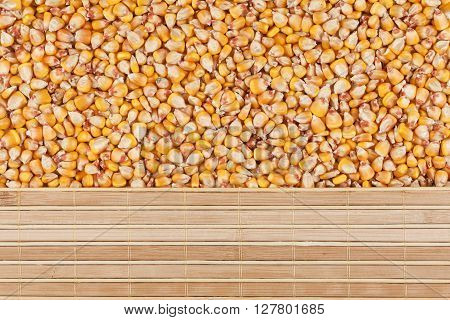Corn grain and bamboo mat with place for your text