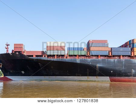 Massive Black Freighter sailing into Savannah River