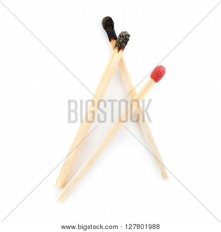 Pile of Wooden used burnt and one unused matches isolated over the white background, as chosen one concept
