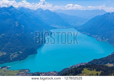 Stunning view of the Brienz lake and the alps from the mountains on hiking trail on Bernese Oberland near the famous tourism region of Interlaken Jungfrau region Switzerland.