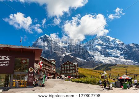 Kleine Scheidegg Switzerland - August 22 2015 -Tourists at the train station of Kleine Scheidegg the transfer station of Jungfrau Railway to the famous Jungfraujoch with view of Eiger and Monch Switzerland.