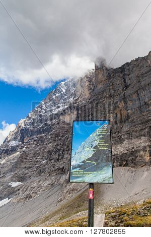 Kleine Scheidegg Switzerland - August 22 2015 - Signpost at the feet of Eiger showing the Heckmair route (first ascent route) on Eiger north face Switzerland.
