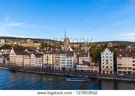 Zurich Switzerland - October 3 2015 - People relax in Zurich old town on the river side of Limmat at dusk Zurich Switzerland.