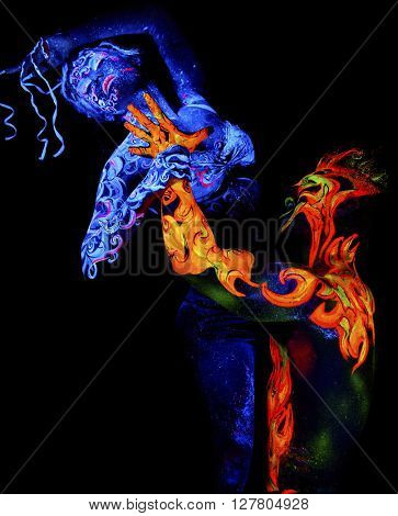 Fire and Air. Body art glowing in ultraviolet light, four elements, isolated on black background
