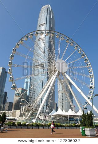 HONG KONG - JAN 17, 2016: Ferris wheel and skyscrapers in Central waterfront on Jan 17, 2015 in Hong Kong, China. It is a popular destination on Hong Kong island.