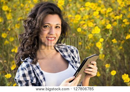 Working With A Tablet Among Flowers